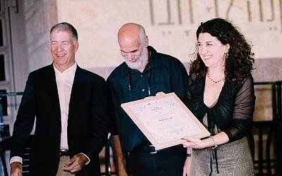 At the ordination ceremony for the first cohort of the Beit Midrash for Israeli Rabbis, Rabba Noga Brenner Samia accepts her certificate from Rabbi Donniel Hartman of the Shalom Hartman Center and Dr. Moti Zeira, CEO of HaMidrasha at Oranim on September 20, 2016. (Netanel Tobias)