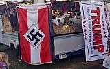 A Nazi flag displayed for purchase on a merchandise vendor's trailer at the Bloomsburg Fair fairgrounds in Bloomsburg, Pennsylvania, September 24, 2016,  (Edward Conner via AP)