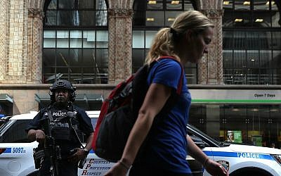 A New York City police officer standing guard outside Grand Central Station in New York City, Sept. 20, 2016. (Justin Sullivan/Getty Images via JTA)