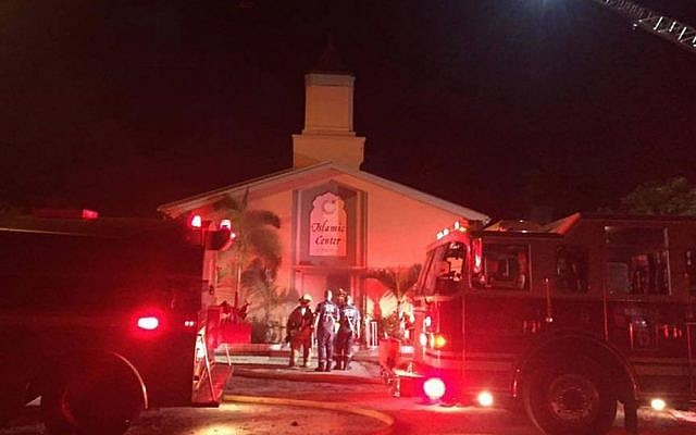 Firefighters work at the scene of a fire at the Islamic Center of Fort Pierce on Monday, September 12, 2016, in Fort Pierce, Florida (St. Lucie Sheriff's Office via AP)
