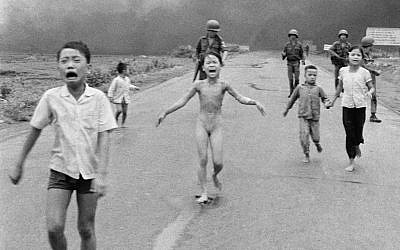 This is a June 8, 1972 file photo of South Vietnamese forces follow after terrified children, including 9-year-old Kim Phuc, center, as they run down Route 1 near Trang Bang after an aerial napalm attack on suspected Viet Cong hiding places . Norway's Prime Minister Erna Solberg on Friday Sept. 9, 2016 challenged Facebook's restrictions on nude photos by posting an iconic 1972 image of a naked girl running from an aerial napalm attack in Vietnam. The Pulitzer Prize-winning image by Associated Press photographer Nick Ut is at the center of a heated debate about freedom of speech in Norway after Facebook deleted it from a Norwegian author's page last month. (AP Photo/Nick Ut, File)