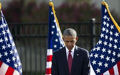 President Barack Obama bows his head for a moment of silence before delivering remarks at the Sept. 11 memorial observance ceremony at the Pentagon, Sunday, Sept. 11, 2016. (AP/Cliff Owen)