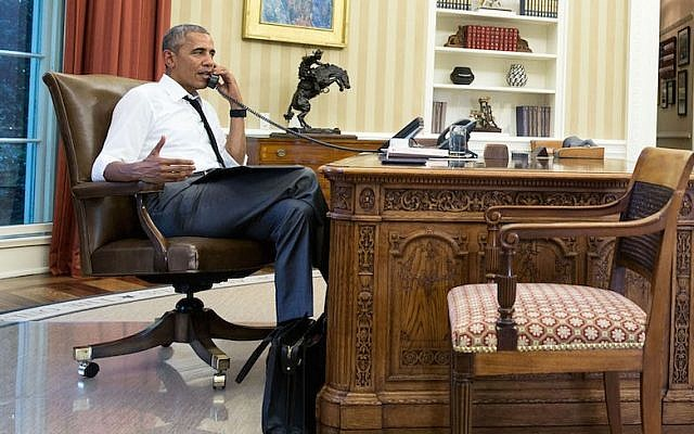 President Barack Obama talking on the phone in the Oval Office, July 15, 2016. (Pete Souza/ Official White House Photo)
