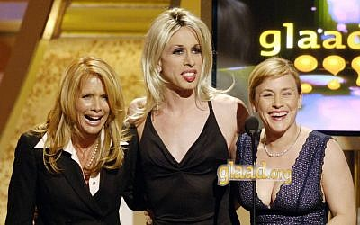 In this April 8, 2006 file photo, acting siblings Rosanna Arquette, from left, Alexis Arquette, center, and Patricia Arquette present an award at the 17th annual Gay and Lesbian Alliance Against Defamation Media Awards in Los Angeles. (AP Photo/Chris Pizzello, File)