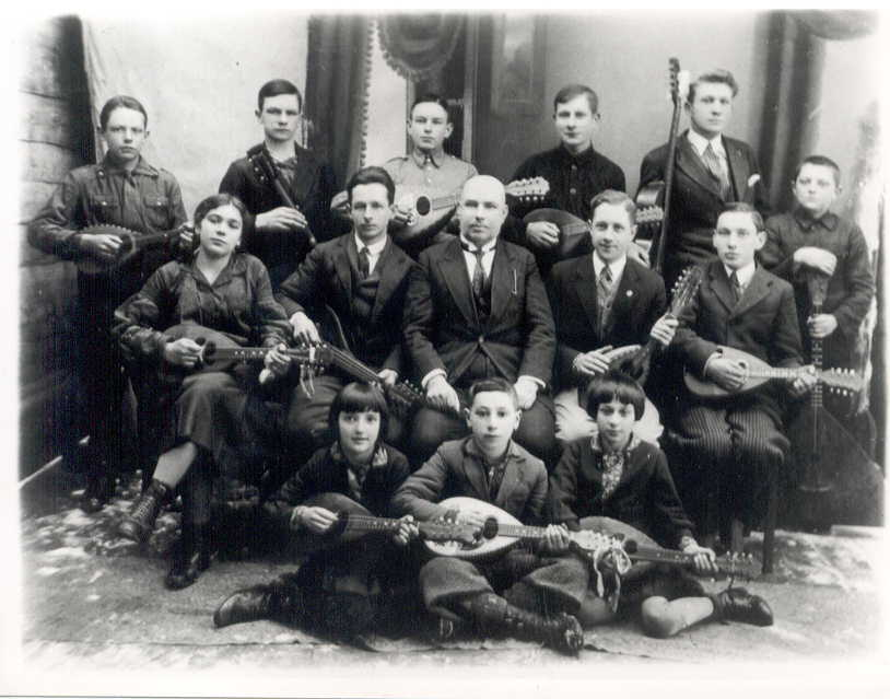 Shimon Peres as a child, sitting in the front row in a mandolin orchestra in what is today Belarus (Shimon Peres Archives)