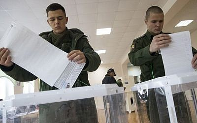 Russian military cadets cast their ballots at a polling station during a parliamentary elections in Moscow, Russia, Sunday, Sept. 18, 2016. (AP Photo/Pavel Golovkin)
