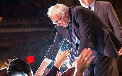 Bernie Sanders, I-Vt., shaking hands with supporters after outlining his plan to reform the US financial sector in New York City, Jan. 15, 2016. (Andrew Burton/Getty Images)