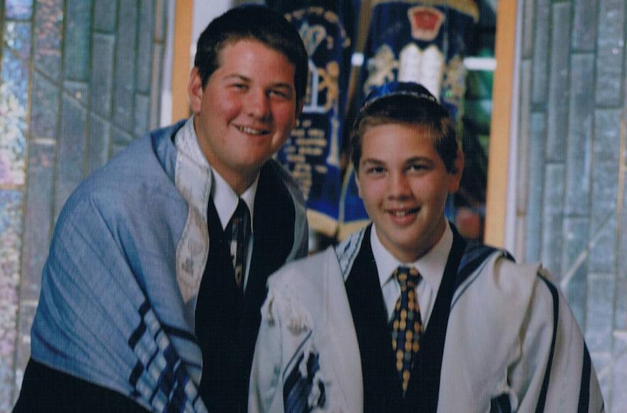 Geoff, left, and Mitch Schwartz at synagogue. (John Solano/via JTA)