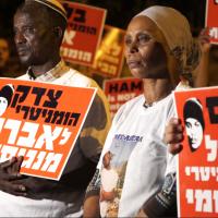 The parents of Avraham Abera Mengistu protest outside the Prime Minister's residence in Jerusalem, September 11, 2016. (Luke Tress/Times of Israel)