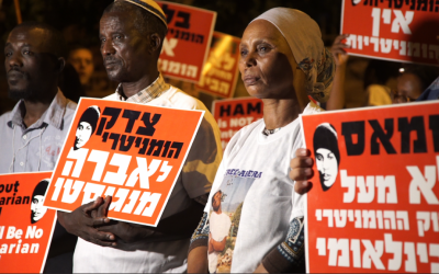 The parents of Avraham Abera Mengistu protest outside the Prime Minister's residence in Jerusalem, September 11, 2016. (Luke Tress/Times of Israel)