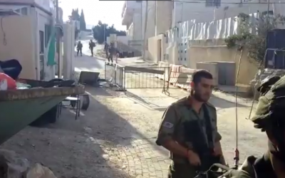 Soldiers at the scene where a soldier was stabbed in Hebron on September 16, 2016 (YouTube screenshot)