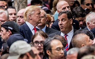 Republican presidential candidate Donald Trump, left, speaks with New Jersey Gov. Chris Christie, right, as he attends a ceremony at the September 11 memorial, in New York, Sunday, September 11, 2016, on the 15th anniversary of the September 11 attacks. (AP Photo/Andrew Harnik)