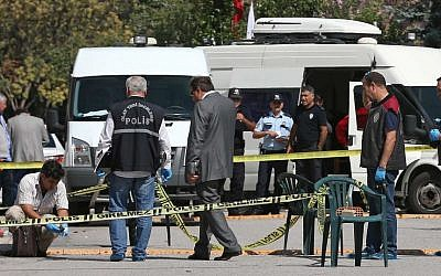 Illustrative: Police officers examine the scene outside the Israeli embassy in Ankara, Turkey where an attacker was shot and wounded, September 21, 2016. (AP Photo/Burhan Ozbilici)