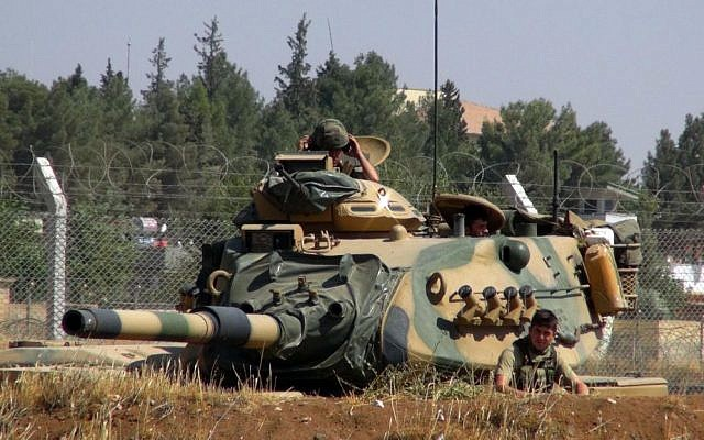 A Turkish army tank stationed near the Syrian border, in Suruc, Turkey, Saturday, Sept. 3, 2016. (AP Photo)