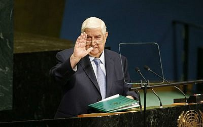 Syria's Foreign Minister Walid Moallem waves after addressing the 71st session of the United Nations General Assembly at UN headquarters, Saturday, Sept. 24, 2016. (AP Photo/Jason DeCrow)