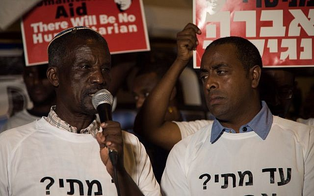 Avraham Abera Mengistu's father, Ayaline, speaks at a protest in front of the Prime Minister's Residence, September 11, 2016. (Luke Tress/Times of Israel)