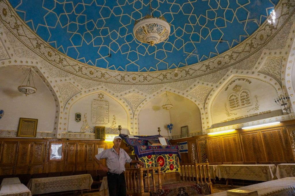 Yossif Tilayev, the caretaker of the Bukharian synagogue in Samarkand, Uzbekistan, explaining about the community, September 11, 2016. (Cnaan Liphshiz/JTA)