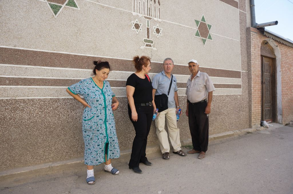 Tamara Tilayev, left, with two community members and her husband, Yosif, right, outside the synagogue in Samarkand, Uzbekistan, September 11, 2016. (Cnaan Liphshiz/JTA)