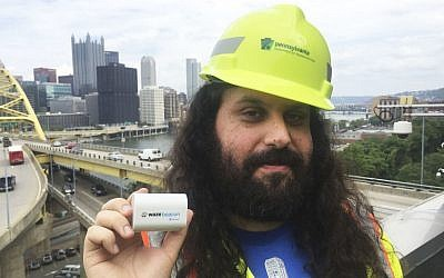 Waze system operation engineer Gil Disatnik holds a Waze beacon in Pittsburgh, where the beacons have been installed in two tunnels, September 8, 2016. (Meghan Kelleher/Courtesy of Waze via AP)