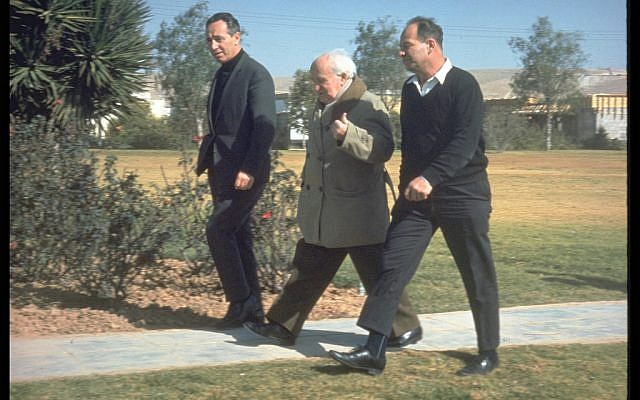 The late former President Shimon Peres with late Prime Minister David Ben Gurion on his daily walks through Kibbutz Sde Boker in 1969. (Defense Ministry Archives)