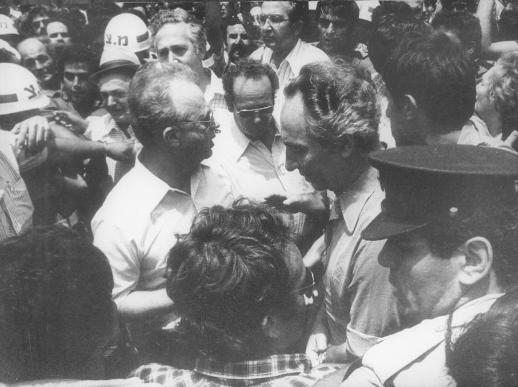 Defense Minister Shimon Peres with PM Yitzhak Rabin receiving the released hostages kidnapped in Entebbe upon their return to Israel in 1976 (Defense Ministry Archives)