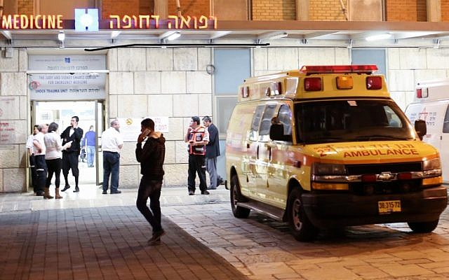 Illustrative photo: Ambulances outside the entrance to the emergency room at Hadassah Ein Kerem hospital, December 3, 2014.  (Noam Revkin Fenton/Flash90)