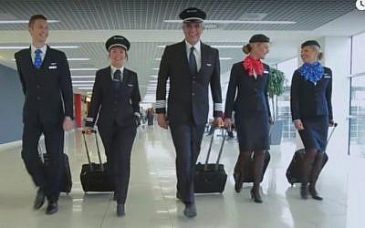 Air Serbia staff prepare to board a plane (Youtube screenshot)