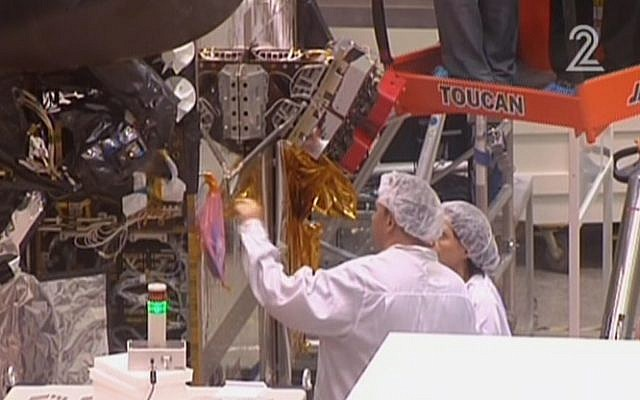 Workers for Israel Aerospace Industries building the Amos-6 satellite, in footage aired September 1, 2016. (screen capture: Channel 2)