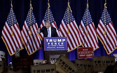 Republican presidential candidate Donald Trump points to the audience after delivering an immigration policy speech during a campaign rally at the Phoenix Convention Center, Wednesday, August 31, 2016. (AP Photo/Matt York)