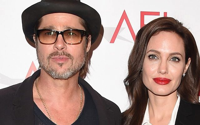 Actor Brad Pitt and actress/director Angelina Jolie attend the 15th Annual AFI Awards at Four Seasons Hotel Los Angeles at Beverly Hills on January 9, 2015 in Beverly Hills, California.  (Jason Merritt/Getty Images)