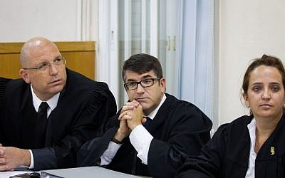 Roi Blecher (L), Oded Savoray and Maya Sagi, the lawyers for Ofek Buchris (not seen), the former military brigadier general accused of rape and other sexual crimes against subordinates, at the Tel Aviv military court on August 28, 2016. (Miriam Alster/FLASH90)