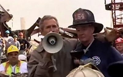 Then US-president George W. Bush delivers a speech alongside emergency rescue personnel at Ground Zero in New York, three days after the September 11, 2001 attacks. (screen capture: YouTube)