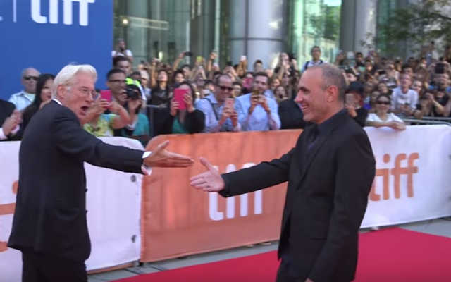 Actor Richard Gere introducing fans to filmmaker Joseph Cedar, who wrote and directed Gere's latest film, at the Toronto International Film Festival this past September. (Courtesy YouTube screen grab)