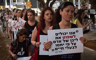 Animal rights protesters march in Tel Aviv, September 8, 2016. The sign reads: 'We can judge the heart of a man by how he treats animals' (Luke Tress/Times of Israel)