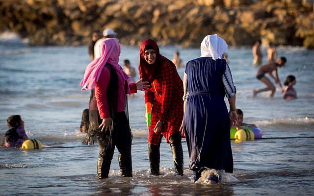 Muslims enjoy Jaffa beach on the second day of the Eid al-Fitr holiday in Tel Aviv-Jaffa on July 7, 2016. Photo by Miriam Alster/Flash90