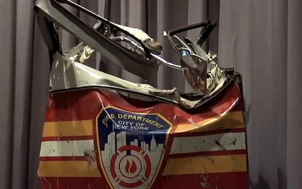 The door of a Fire Department of New York truck, salvaged from the ruins of the World Trade Center after the September 11, 2001 attacks  (screen capture: YouTube)