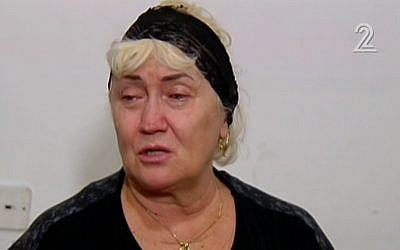 Galina Yakubov, whose husband Oleg Yakubov was killed in the collapse of a garage in Ramat Hahayal, talks to the media at her Tel Aviv home on September 7, 2016. (screen capture: Channel 2)