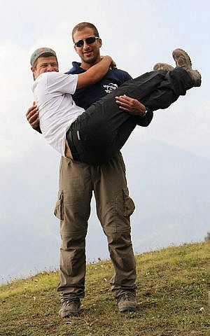 The Cassel brothers, Enosh (standing) and Hanan at the end of their Himalayan trek (Courtesy 'My Hero Brother')