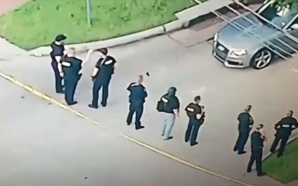 Police officers at the scene of a shooting in Houston, Texas, on Monday, September 26, 2016 (screen capture: YouTube)