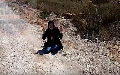 A woman carrying a knife is arrested outside the West Bank settlement of Itamar on September 18, 2016 (YouTube screenshot)