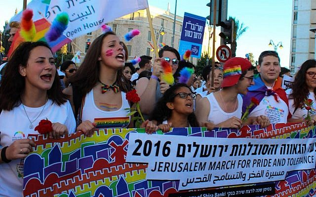 Representatives of the Jerusalem Open House march in the city's 2016 Gay Pride Parade, July 21, 2016. (Adi Eddie)