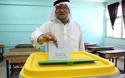 A Jordanian casts his vote in elections, Amman, Jordan, Tuesday, Sept. 20, 2016. (AP Photo/Raad Adayleh)