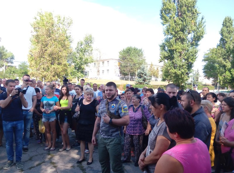 A group of the townspeople meet in Loshchynivka, Ukraine following the pogrom against the town's Roma population. (courtesy of Marianna Zlobina)