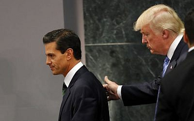 Republican presidential nominee Donald Trump walks with Mexican President Enrique Pena Nieto at the end of their joint statement at Los Pinos, the presidential official residence, in Mexico City, Wednesday, August 31, 2016. (AP Photo/Dario Lopez-Mills)