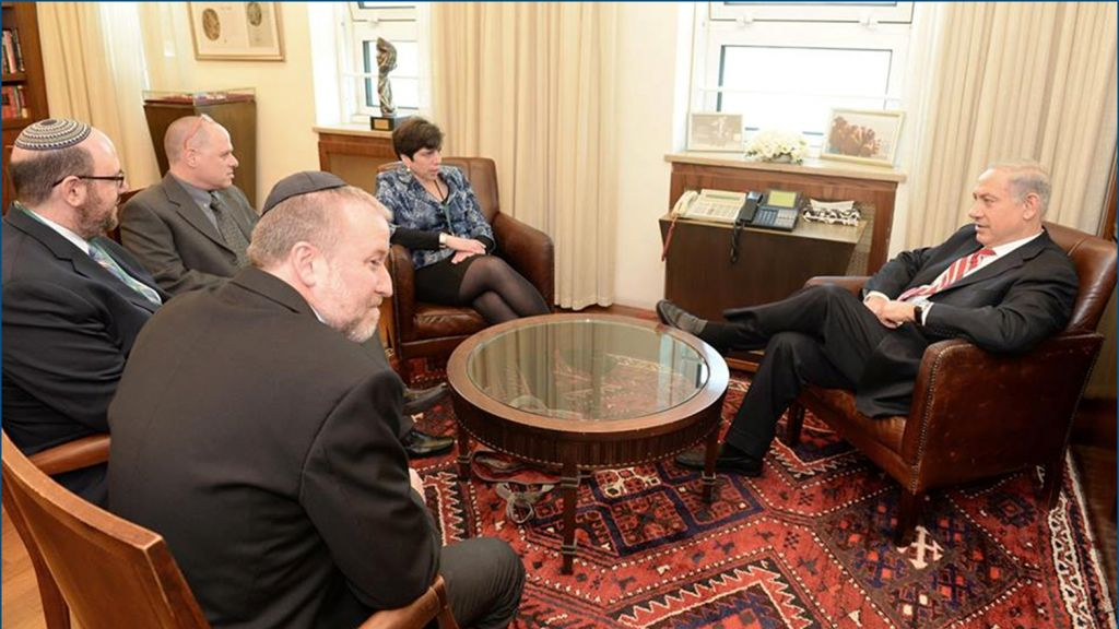 One of the many negotiation meetings leading up to the January 2016 Western Wall compromise. Here at Prime Minister Benjamin Netanyahu's office, with former Cabinet Secretary Avichai Mandelblit (black jacket), Rabbi Steven Wernick, head of United Synagogue for Conservative Judaism, executive director on the Masorti Movement Yizhar Hess (glasses) , and Rabbi Julie Schonfeld, head of the Conservative movement's Rabbinical Assembly. (courtesy Yizhar Hess)