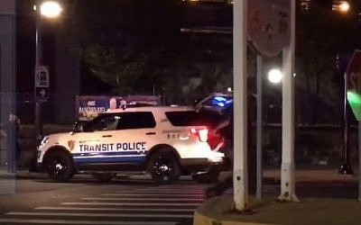 Police in New Jersey rush to the train station in Elizabeth, New Jersey where 5 explosive devices were discovered in a garbage can on September 19, 2016. (screen capture: YouTube)