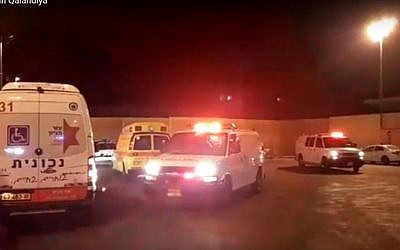 Ambulances and police cars near the Qalandia checkpoint on Friday evening, September 30, 2016. (Screen capture YouTube)