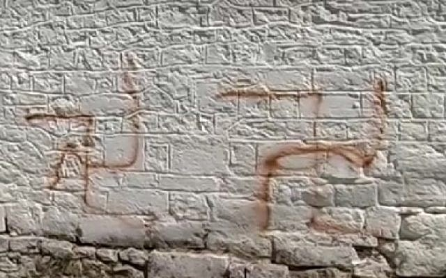 Illustrative: Swastika graffiti outside the synagogue of Ioannina in northwestern Greece, September 12, 2016. (Screenshot/ITV)