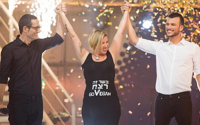 Animal rights activity Tal Gilboa celebrates her win on the hit reality TV show Big Brother, August 30, 2014. The Hebrew on her shirt reads: 'Meat is murder.' (Yonatan Sindel/Flash90)