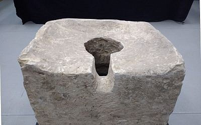 An 8th century BCE 'symbolic' toilet found at Lachish during the 2016 excavation by Israel Antiquities Authority archaeologists. (Ilan Ben Zion/Times of Israel staff)